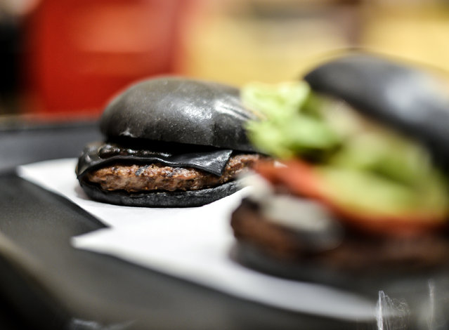Black hamburgers are seen at a Burger King restaurant on September 18, 2014 in Tokyo, Japan. (Photo by Keith Tsuji/Getty Images)