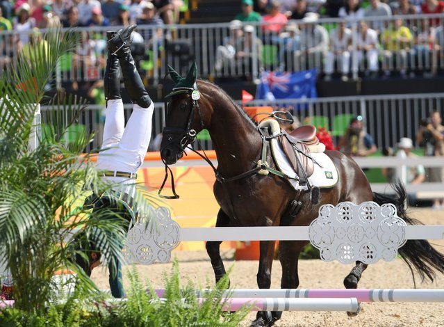 Ruy Fonseca of Brazil is thrown off his horse, Tom Bombadill Too, as the horse refuses a jump during the Individual Jumping competition, August 9, 2016. (Photo by Jim Hollander/EPA)