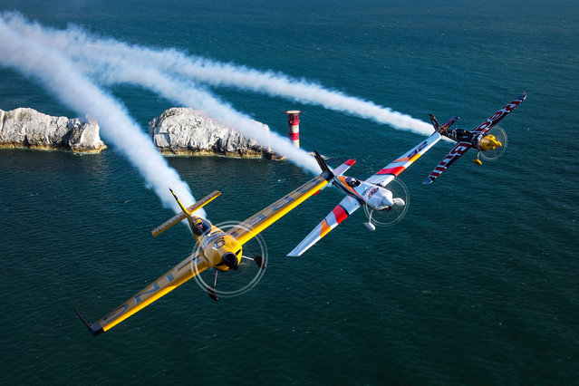 Nigel Lamb from Great Britain, left, leading Juan Velarde of Spain, centre, and Martin Šonka of Czech Republic in the FAI Red Bull air race, Isle of Wight, UK on August 9, 2016. (Photo by Joerg Mitter/Red Bull/Global New/PA Wire)