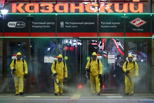 Russian Emergency Situations Ministry employees carry out disinfection of Kazansky Railway Station in Moscow, Russia on May 28, 2020,  amid the ongoing COVID-19 pandemic. (Photo by Anton Novoderezhkin/TASS)