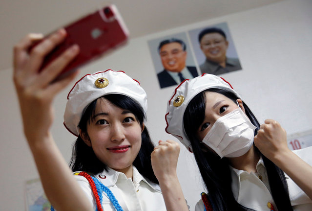 Chunhun, the leader of Japan's North Korea fan club called sengun-joshi poses for a selfie with another member in Tokyo, Japan on November 2, 2017. (Photo by Toru Hanai/Reuters)