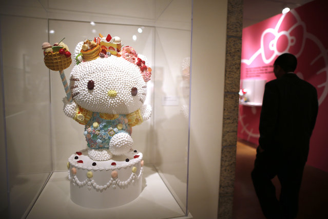 """People view """"Sweet Kitty"""" by Osamu Watanabe at the """"Hello! Exploring the Supercute World of Hello Kitty"""" museum exhibit in honor of Hello Kitty's 40th anniversary, at the Japanese American National Museum in Los Angeles, California October 10, 2014. (Photo by Lucy Nicholson/Reuters)"""