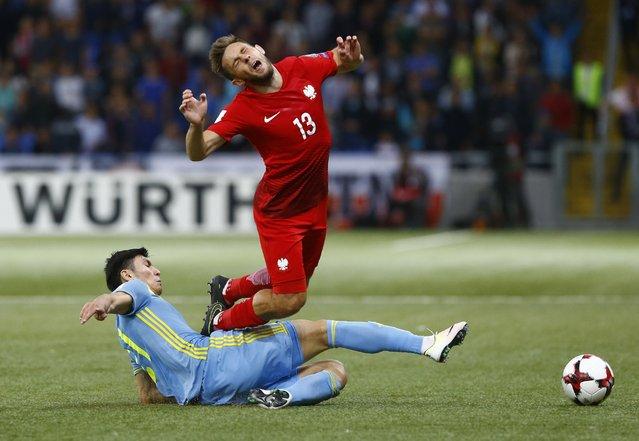Football Soccer, Kazakhstan vs Poland, World Cup 2018 Qualifiers, Astana Arena stadium, Astana, Kazakhstan on September 4, 2016. Kazakhstan's Abzal Beysebekov in action against Poland's Maciej Rybus. (Photo by Shamil Zhumatov/Reuters)