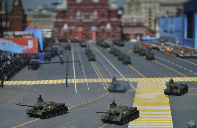 Soviet SU-100 tank destroyers drive during the Victory Day parade at Red Square in Moscow, May 9, 2015. Picture taken with a tilt and shift lens. (Photo by Reuters/RIA Novosti)
