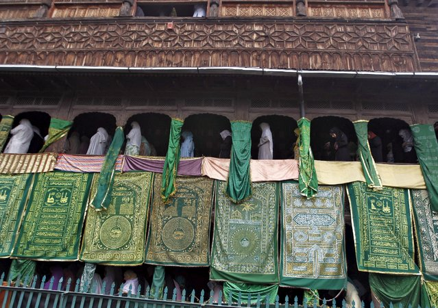 Kashmiri Muslim women offer prayers at the shrine of Mir Syed Ali Hamdani, a Sufi saint, during a religious festival to mark Saint Hamdani's birth anniversary in Srinagar September 21, 2015. Thousands of Kashmiri Sufi Muslim devotees visited the shrine of Saint Hamdani, who travelled to Kashmir from Iran to spread Islam in the region, for the anniversary of his birth on Monday. (Photo by Danish Ismail/Reuters)