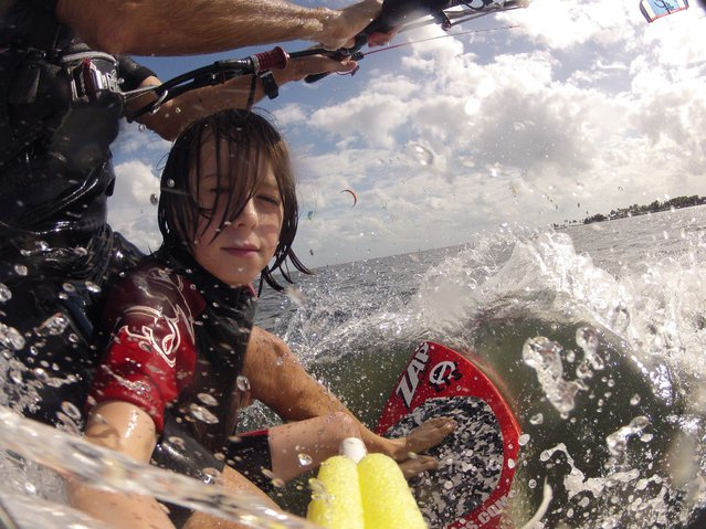 """Lonny & Dylan by Patrick Rynne. As if kiting on a skimboard isn't hard enough, try doing it with a GoPro in one hand and your nephew holding onto your legs! Lonny & Dylan Morris tandem #waterlusting in Miami. Video coming soon!"". (Photo by Patrick Rynne)"