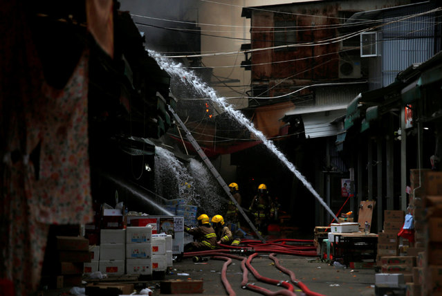 Firefighters put out a fire at Yau Ma Tei Wholesale Fruit Market in Hong Kong, China September 4, 2016. (Photo by Tyrone Siu/Reuters)