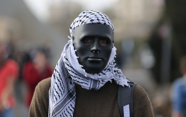 A Palestinian protester is seen during clashes with Israeli troops near the Jewish settlement of Bet El, near the West Bank city of Ramallah October 8, 2015. (Photo by Mohamad Torokman/Reuters)