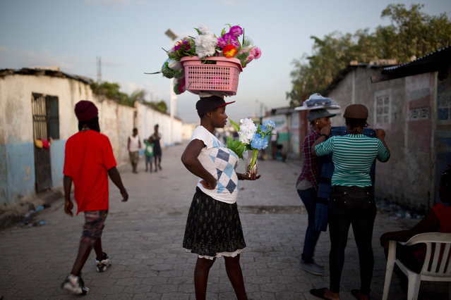 A street vendors sells items in Cite Soleil, an extremely impoverished and densely populated slum in Port-au-Prince, Haiti, on December 27, 2017. (Photo by Dieu Nalio Chery/AP Photo)
