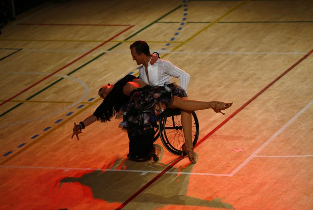 Ivan Sivak and Olesia Kostak of Ukraine dance during IPC Wheelchair Dance Sport European Championships in Lomianki near Warsaw, November 9, 2014. (Photo by Kacper Pempel/Reuters)