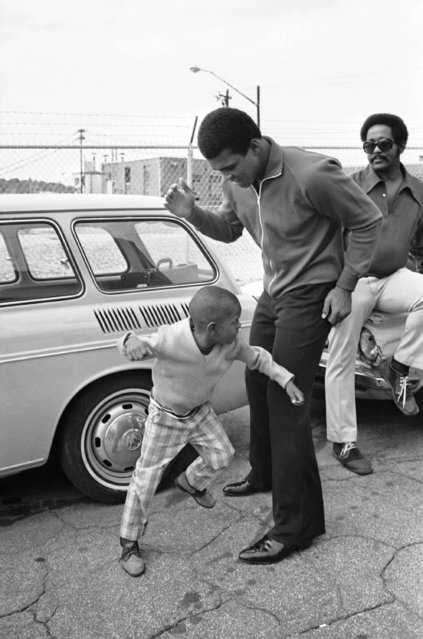 Former heavyweight champion Muhammad Ali spars fun with 6-year-old Henry Joyner after working out in Atlanta on October 16, 1970. Muhammad Ali meets Jerry Quarry in a 15-round non-title fight on October 26 in Atlanta. Ali won his heavyweight title under the name of Cassius Clay. (Photo by AP Photo)