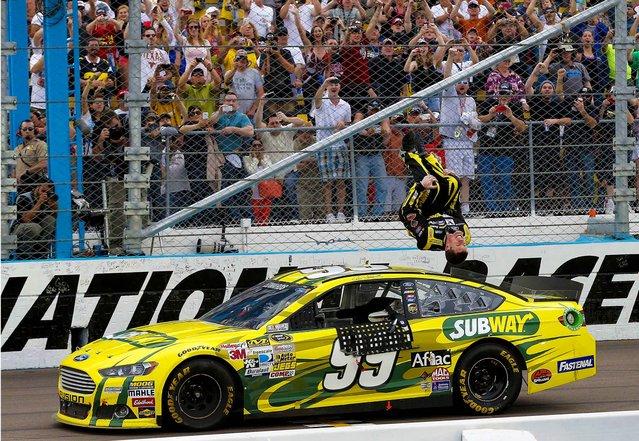 Carl Edwards celebrates winning the NASCAR Sprint Cup Series race in Avondale, Arizona, March 3, 2013. (Photo by Matt York/Associated Press)