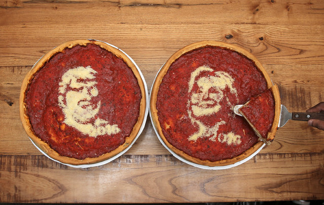Pizza's decorated with the images of U.S. Democratic presidential nominee Hillary Clinton (R) and Republican presidential nominee Donald Trump at Giordano's Pizzeria in Chicago, Illinois, U.S., September 27, 2016. (Photo by Jim Young/Reuters)
