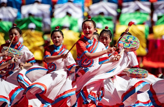 Dancers perform during a gala in celebration of the 70th anniversary of the liberation of Qamdo, in Qamdo City, southwest China's Tibet Autonomous Region, October 9, 2020. (Photo by Purbu Zhaxi/Xinhua News Agency)