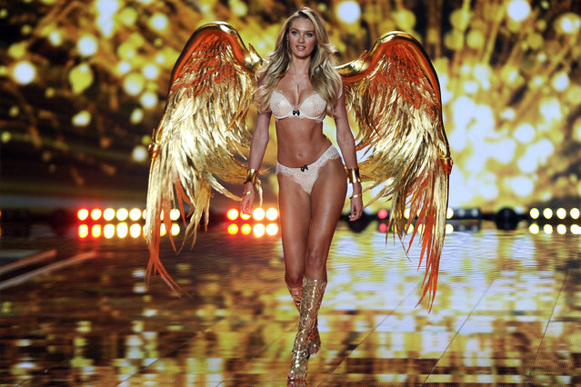 South African model Candice Swanepoel takes to the catwalk during the 2014 Victoria's Secret Fashion Show at the Earls Court Exhibition Centre in London, Britain, 02 December 2014. (Photo by Facundo Arrizabalaga/EPA)