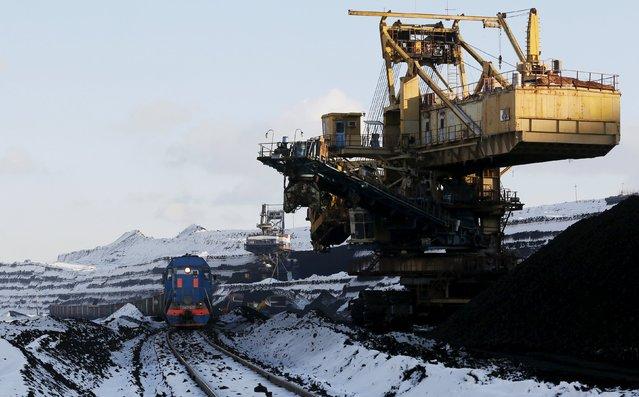 A rotary dredge works on the coal face of the Borodinsky opencast colliery near the Siberian town of Borodino, east of Krasnoyarsk, Russia, October 27, 2015. (Photo by Ilya Naymushin/Reuters)