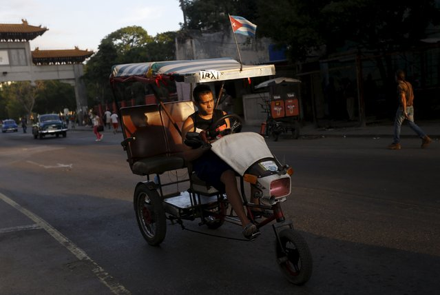 A man rides his tricycle taxi on a street in Havana October 26, 2015. (Photo by Reuters/Stringer)