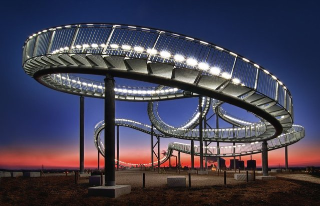 """""""Of the Tiger and Turtle"""" is a work of art on an industrial landmark. (Photo by Peter Mysticdidge Plorin/2013 Sony World Photography Awards)"""