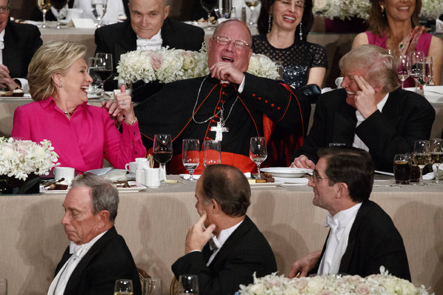 Republican presidential candidate Donald Trump, right, Cardinal Timothy Dolan, Archbishop of New York, center, and Democratic presidential candidate Hillary Clinton share a laugh during the Alfred E. Smith Memorial Foundation dinner, Thursday, October 20, 2016, in New York. (Photo by Evan Vucci/AP Photo)