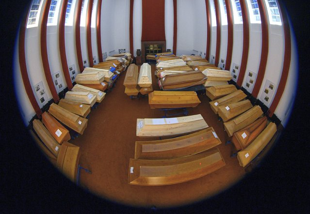 Coffins containing the deceased stand in the crematorium's worship room before cremation in Meissen, Germany, Friday, January 8, 2021. Most of them have died of or with the coronavirus. (Photo by Robert Michael/dpa via AP Photo)
