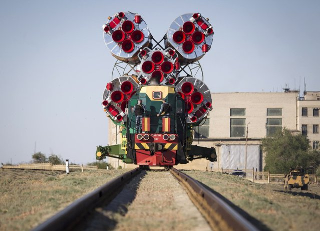 The Soyuz TMA-09M spacecraft is transported to its launch pad at Baikonur cosmodrome May 26, 2013. Soyuz with U.S. astronaut Karen Nyber, Italian astronaut Luca Parmitano and Russian cosmonaut Fyodor Yurchikhin is due to travel to the International Space Station on May 29. (Photo by Shamil Zhumatov/Reuters)