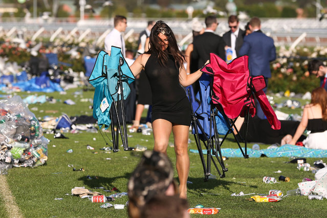 A racegoer enjoy the atmosphere following 2016 Derby Day at Flemington Racecourse on October 29, 2016 in Melbourne, Australia. Women attendees weren't afraid to show off some skin as the warm summer weather arrived in Australia. (Photo by Splash News and Pictures)
