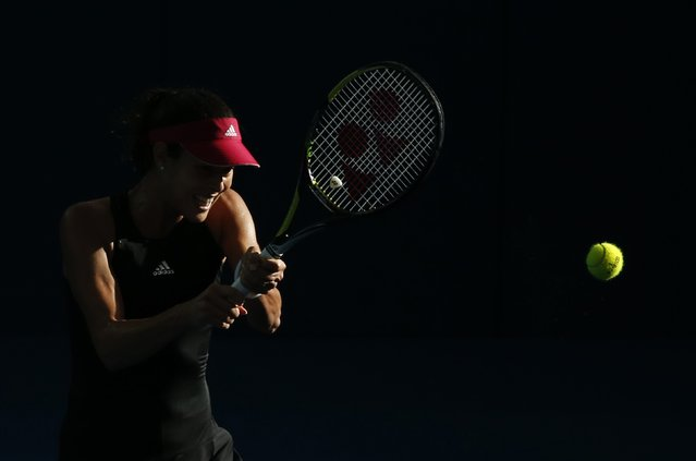 Ana Ivanovic of Serbia plays a backhand return in the afternoon light during her women's singles semi-final match against Varvara Lepchenko of the U.S. at the Brisbane International tennis tournament in Brisbane, January 9, 2015. (Photo by Jason Reed/Reuters)