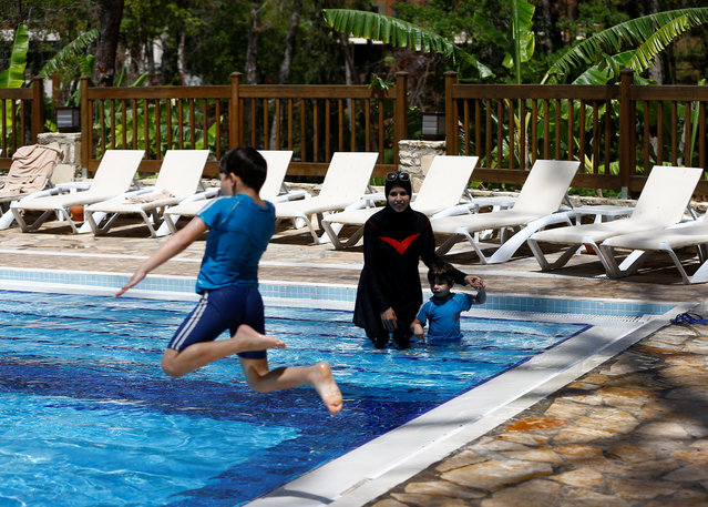 Guests enjoy the pool at Wome Deluxe Hotel in Alanya, Turkey on May 23, 2018. Only 60 or so hotels and resorts offer halal-friendly breaks, out of many thousands of hotels across Turkey, but a report in November said Turkey has jumped four places to the third most popular destination for Islamic holidays, behind the United Arab Emirates and Malaysia. (Photo by Osman Orsal/Reuters)