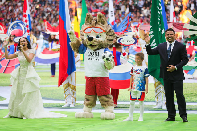 Garifullina is joined by the 2018 World Cup mascot, Zabivaka, and legendary Brazilian footballer Ronaldo during the opening ceremony before the Russia 2018 World Cup Group A football match between Russia and Saudi Arabia at the Luzhniki Stadium in Moscow on June 14, 2018. (Photo by Sergei Bobylev/TASS via Getty Images)