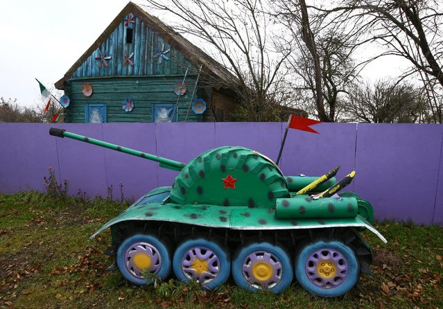 An installation with a copy of a tank is seen at a villager's house in the village of Vits, Belarus November 8, 2016. (Photo by Vasily Fedosenko/Reuters)