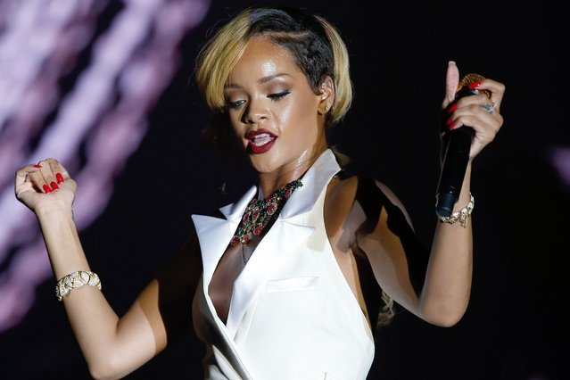 Barbadian singer Rihanna performs on stage in Monaco, on July 11, 2013. (Photo by Valery Hache/AFP Photo)