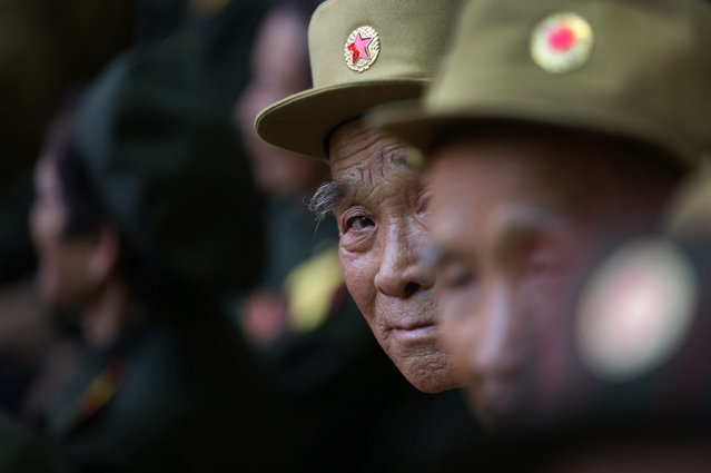 "North Korean war veterans of the Korean War watch the ""Arirang"" mass games song-and-dance ensemble at the May Day stadium, Friday, July 26, 2013 on the eve of the 60th anniversary of the Korean War armistice in Pyongyang, North Korea. (Photo by Wong Maye-E/AP Photo)"