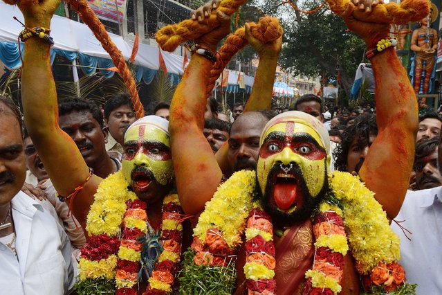 Indian Hindu devotees representing Potharaju, brother of the goddess Mahankali, dance in the streets during the Bonalu festival at the Sri Ujjaini Mahakali Temple in Secunderabad, India, on July 30, 2013. (Photo by Noah Seelam/AFP Photo)