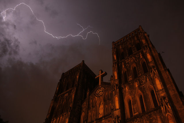 Lighting strikes over Saint Joseph cathedral during a storm in Hanoi, July 2012. (Photo by Carlos Barria/Reuters)