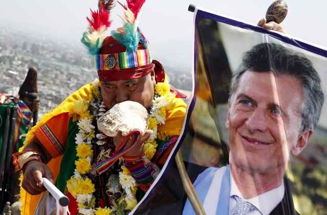 Peruvian shamans holding a poster of Argentinian President Mauricio Macri perform a ritual of predictions for the new year at Morro Solar hill in Chorrillos, Lima, Peru, December 29, 2015. (Photo by Mariana Bazo/Reuters)