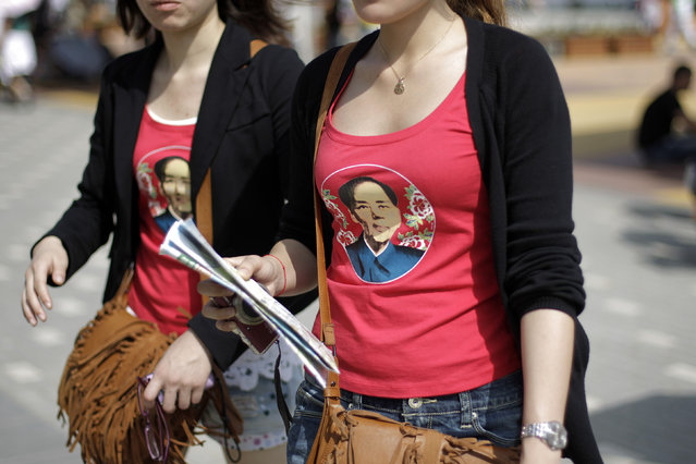 Visitors wear shirts with an image of former Chinese leader Mao Zedong at the Shanghai World Expo site in Shanghai, May 2, 2010. (Photo by Aly Song/Reuters)