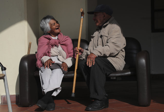 Elderly residents chat at the Patronato San Jose senior home, created to benefit theabandoned elderly in Quito, Ecuador, Friday, March 19, 2021, amid the new coronavirus pandemic. (Photo by Dolores Ochoa/AP Photo)