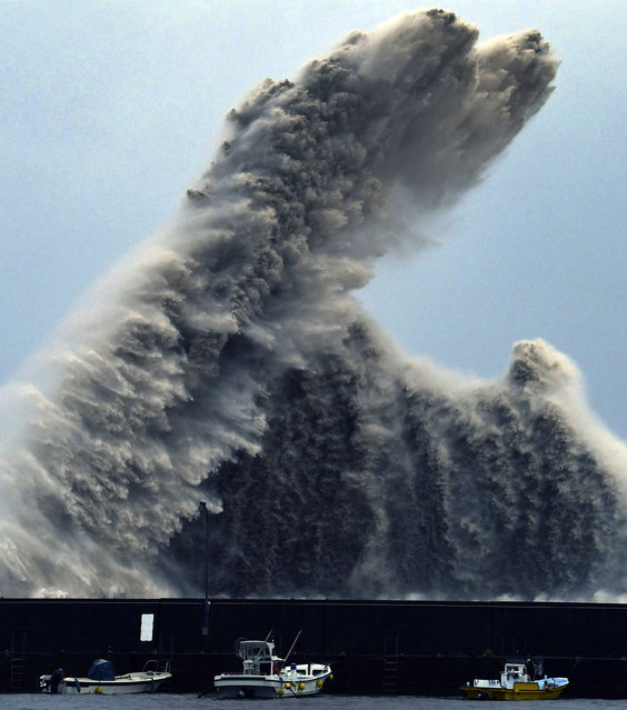 High wave hits a breakwater in Aki city, Kochi prefecture, western Japan as a typhoon Cimaron approached the area. (Photo by Chika Oshima/Kyodo News via AP Photo)