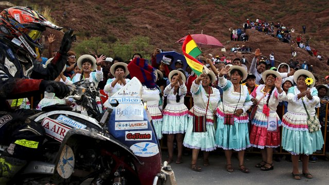 Sergei Karyakin of Russia rides his Yamaha quad as Bolivian women cheer during the seventh stage in the Dakar Rally 2016 in Tupiza, Bolivia, January 9, 2016. (Photo by Marcos Brindicci/Reuters)