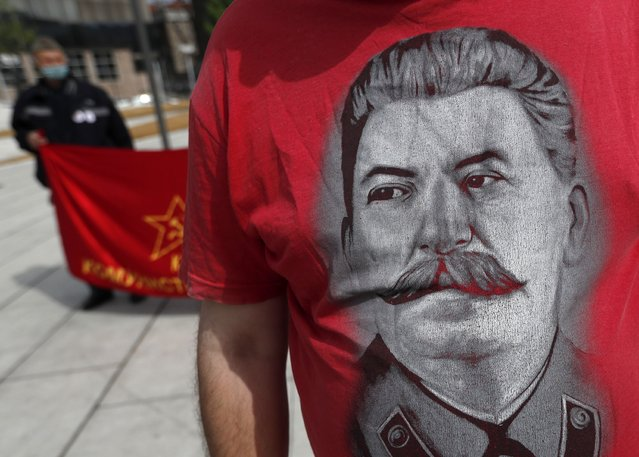 A man wearing a shirt with the image of former Soviet dictator Joseph Stalin attends a May Day rally on International Workers Day in Belgrade, Serbia, Saturday, May 1, 2021. Activists marked May Day with defiant rally. (Photo by Darko Vojinovic/AP Photo)