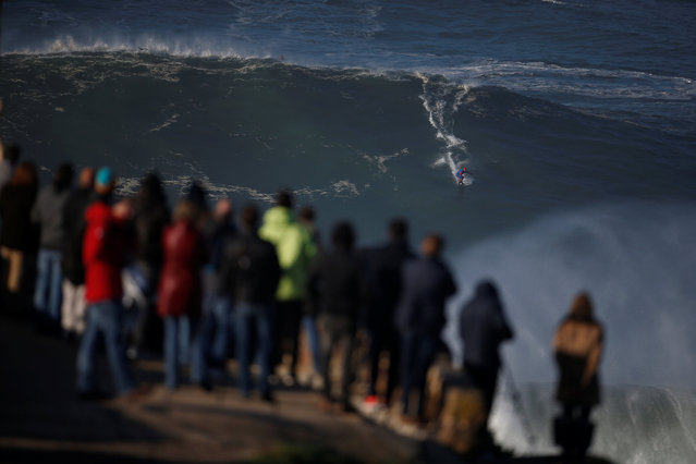 French Brazilian surfer Eric Xavier drops in on a large wave at Praia do Norte in Nazare, Portugal December 17, 2016. (Photo by Rafael Marchante/Reuters)