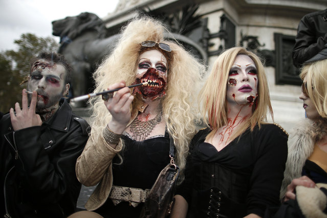 Four men dressed as zombies participate in a Zombie Walk procession in the streets of Paris October 12, 2013. (Photo by Benoit Tessier/Reuters)