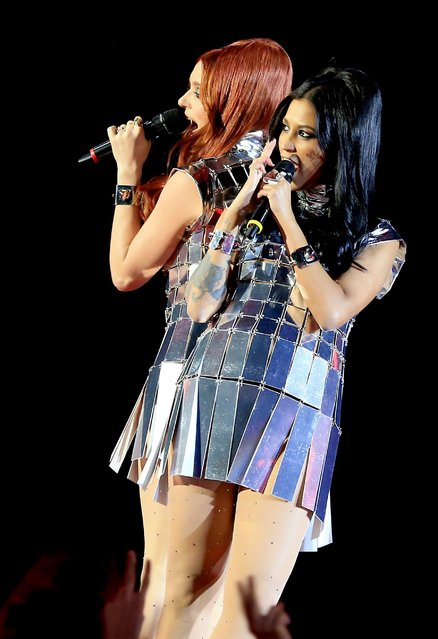 Swedish band Icona pop performs during the MTV Europe Music Awards (EMA) 2013 ceremony in the Ziggo Dome, in Amsterdam on November 10, 2013. (Photo by Sven Hoogerhuis/AFP Photo)
