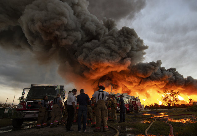 Emergency services personnel at the scene of a fire at a recycling plant near Carolina, Puerto Rico on November 27, 2018. (Photo by El Nuevo Dias/Rex Features/Shutterstock)