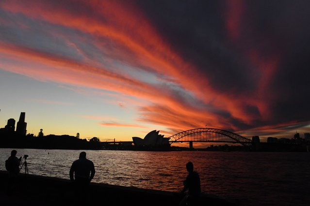 The Sydney Opera House and Sydney Harbour Bride are seen during a sunset in Sydney, Tuesday, April 20, 2021. (Photo by Mick Tsikas/AAP Image)
