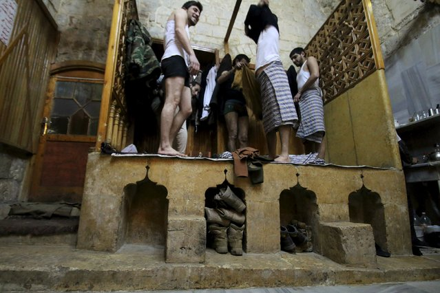 Free Syrian Army fighters prepare to take a steam bath at al-Salhiyeh traditional hammam, at a rebel-controlled area in the old city of Aleppo, Syria January 26, 2016. (Photo by Abdalrhman Ismail/Reuters)