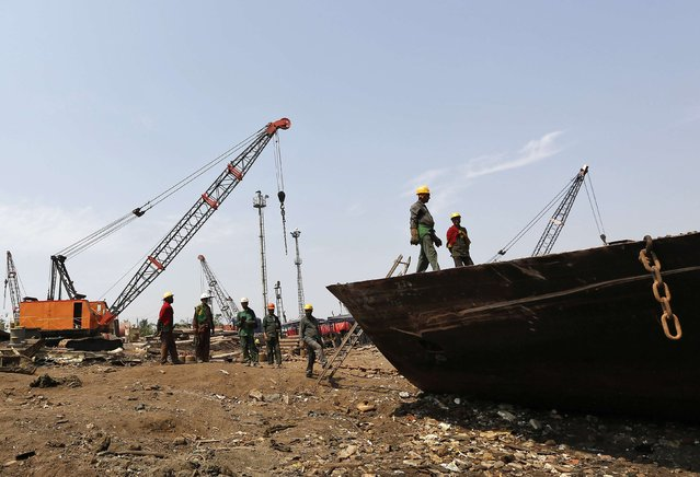Workers prepare to dismantle a decommissioned ship at the Alang shipyard in the western Indian state of Gujarat, March 27, 2015. (Photo by Amit Dave/Reuters)