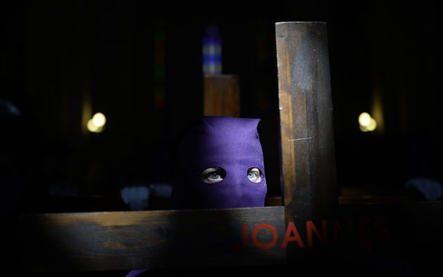 "A penitent from ""El Calvario"" brotherhood takes part during a Holy Week procession in Cordoba, Spain, Wednesday, April 1, 2015. (Photo by Manu Fernandez/AP Photo)"