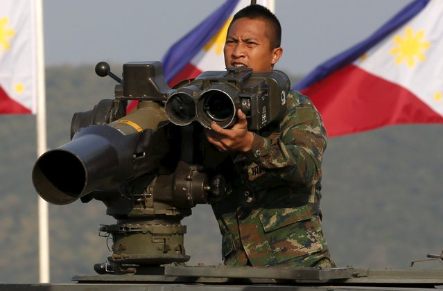 A Thai soldier prepares his equipment as he participates in the opening ceremony for the Cobra Gold military exercise at the Royal Thai Marine corps headquarter in Chonburi, east of Bangkok February 9, 2016. The largest multilateral military exercise in Asia-Pacific kicked off on Tuesday in Thailand, with the United States maintaining a scaled down presence due to a 2014 coup in Bangkok and calling for a swift return to democracy. (Photo by Chaiwat Subprasom/Reuters)