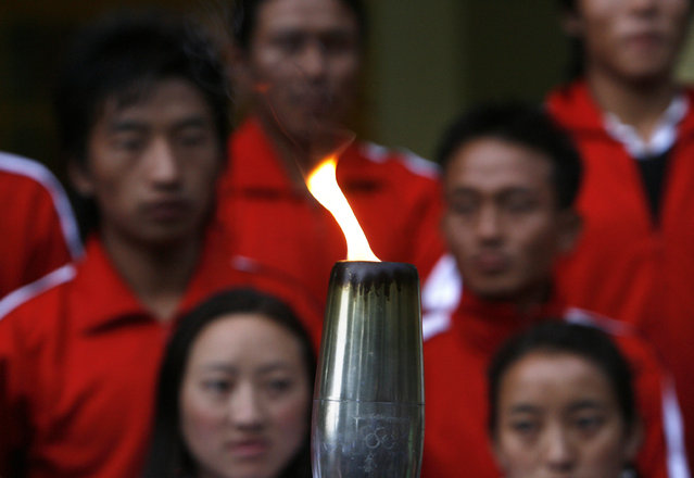 Tibetan exiles hold the Tibetan Olympics 2008 torch during a symbolic relay in the northern hill town of Dharamsala, May 2008. (Photo by Desmond Boylan/Reuters)